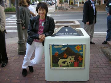 Artist Angie Young with her art on public display
